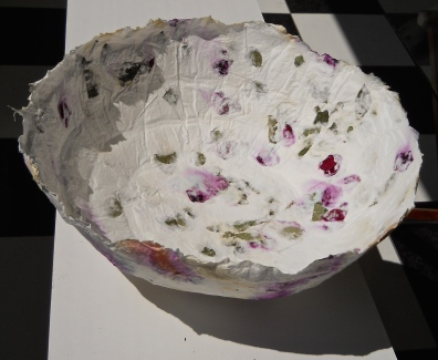 casting handmade paper with rose petals and leaves from installation