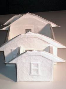 """cast paper model of the """"smallest house known to man"""" as seen through the peephole of the Home Making exhibition"""