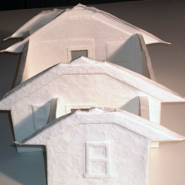 "cast paper model of the ""smallest house known to man"" as seen through the peephole of the Home Making exhibition"