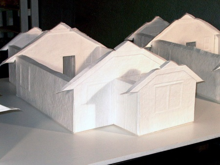 "cast paper models of the ""smallest house known to man"" .5inch:1foot in the exhibition Home Making at Two Rivers Gallery"