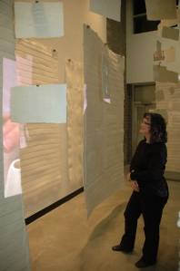 viewer in installation of Home Making at Two Rivers Gallery