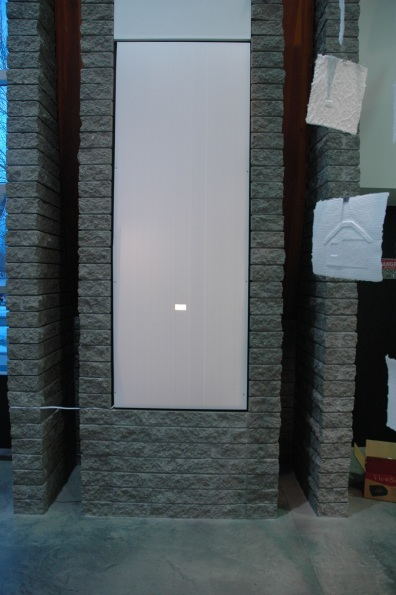 """Home Making Installation - peephole through which viewers could see the interior of the """"smallest house known to man"""""""