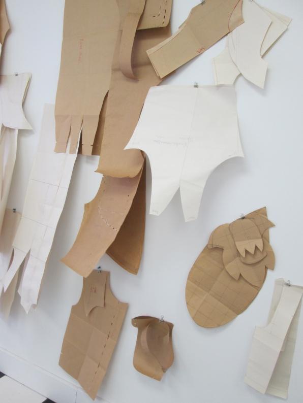 Barbara's patterns hanging in storefront studio