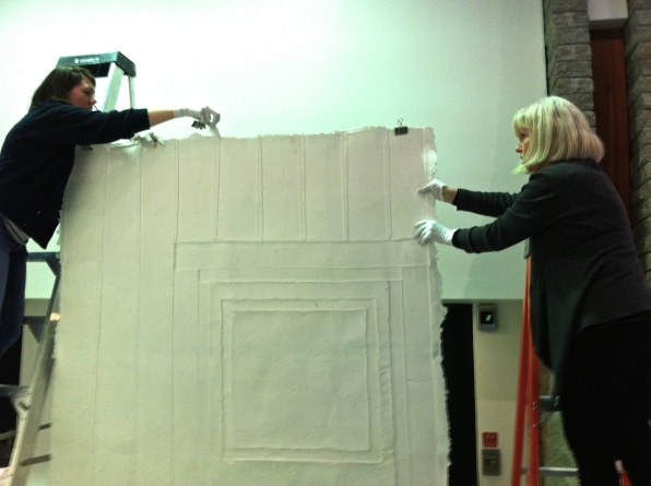 installing a cast paper wall with Maeve Hanna and myself