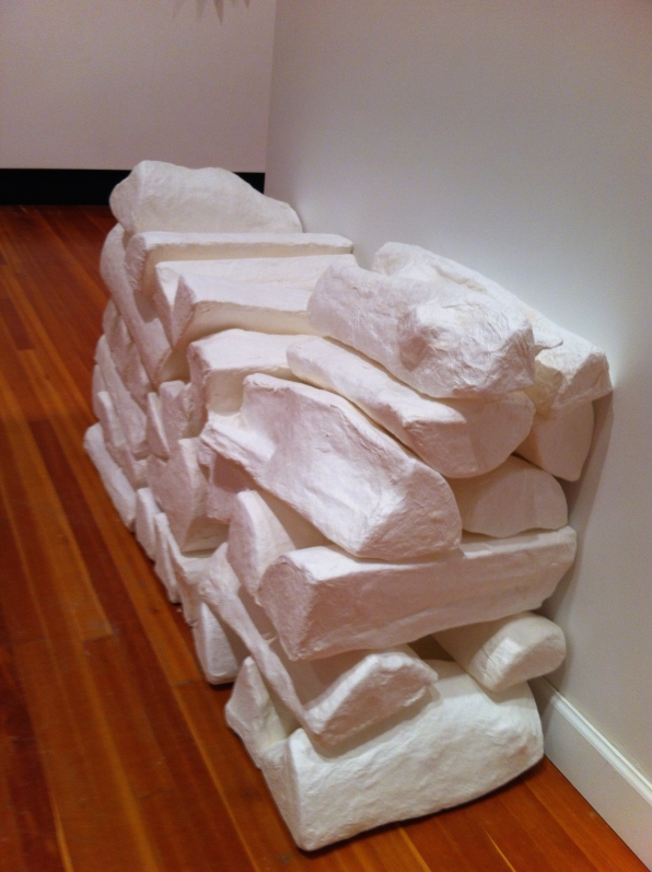 cast paper firewood in North exhibition, TwoRivers gallery, Prince George, BC