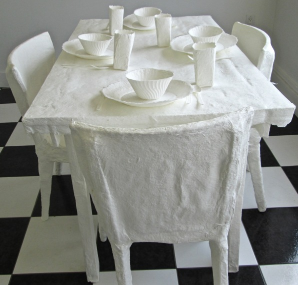 cast paper table, chairs, and place settings