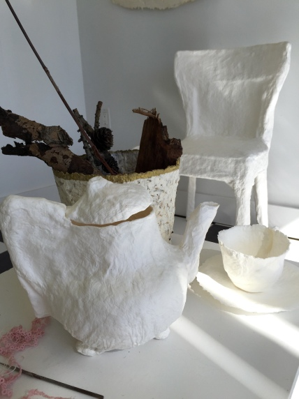 cast paper teapot, tea cup, saucer and chair