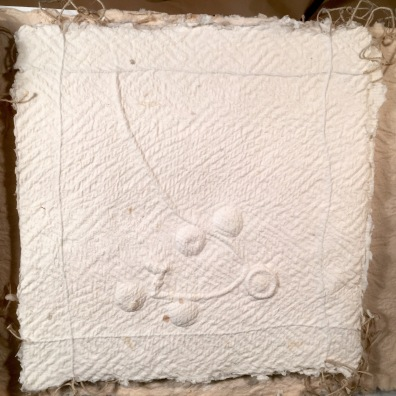 handmade paper, embossed and embedded with metal objects, linen yarn objects from my maternal family