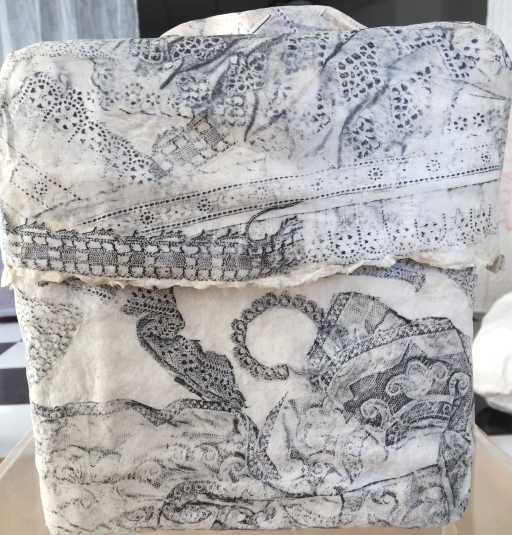 trunk with lace embossed prints